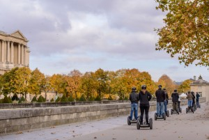 Tour groups of tourists on the streets of Paris by Segway