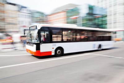 53680922 - driving bus in city traffic in motion blur